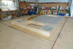 Ein Holzhaus entsteht im Werk